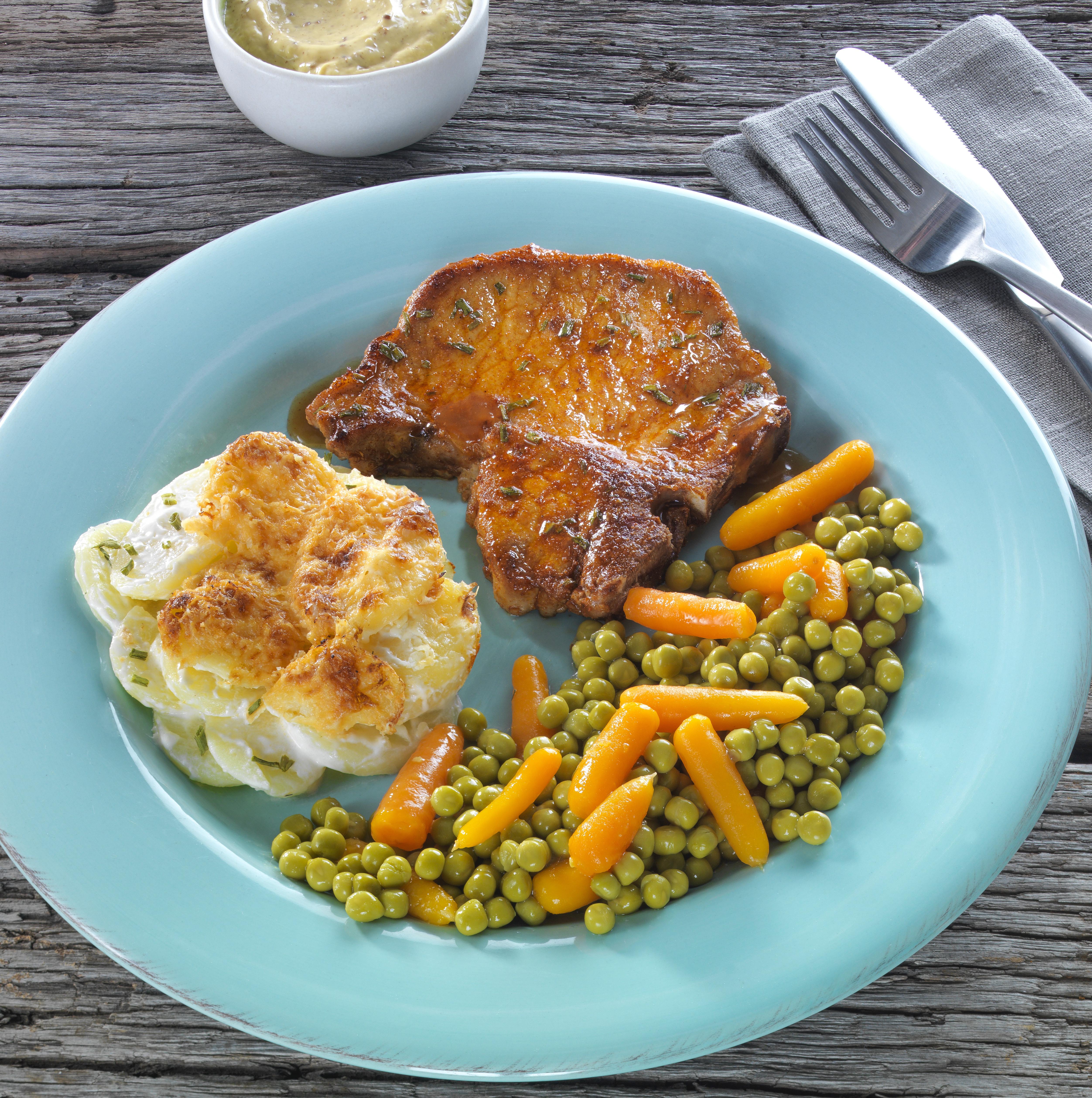 Varkenskotelet Doperwten Wortel Aardappelgratin